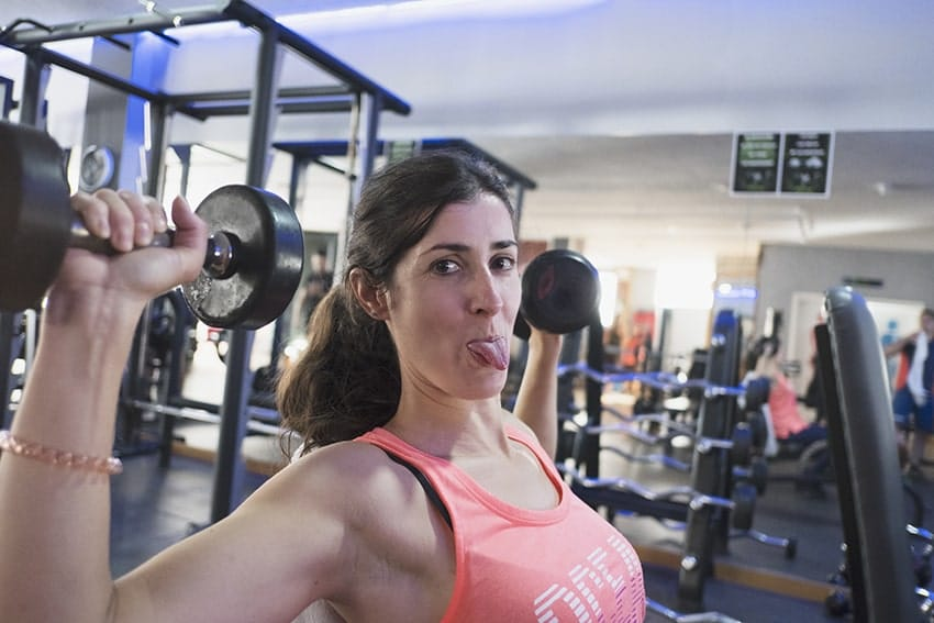 Woman working out while sticking out her tongue