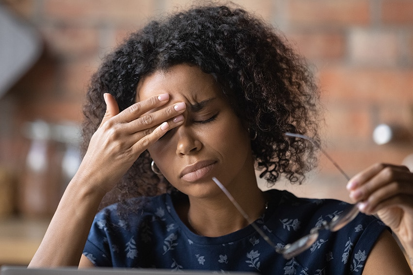 young woman suffering from migraine headache